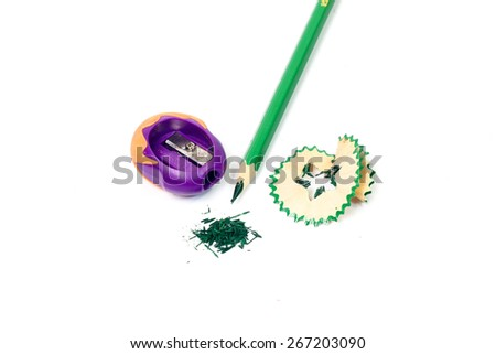 The green colored pencils with a Sharpener - stock photo