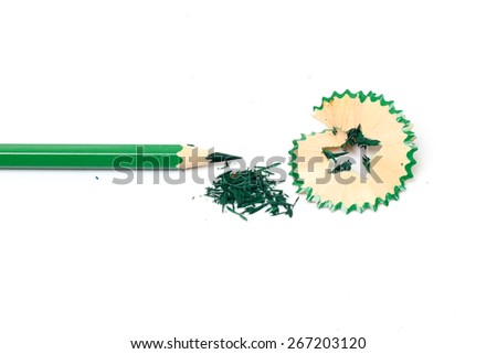 The green colored pencils with a sharpener on a white background. - stock photo