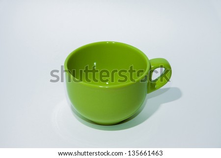 The green cup on the white background
