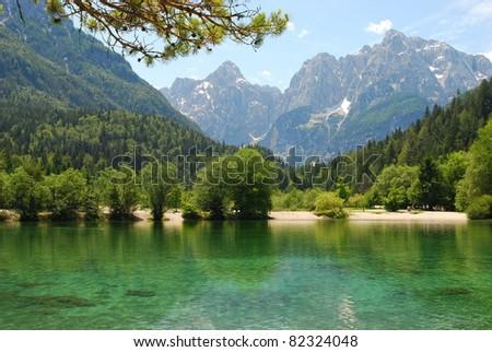The green, emerald Jasna lake near Kranjska Gora in Slovenia, Europe - stock photo