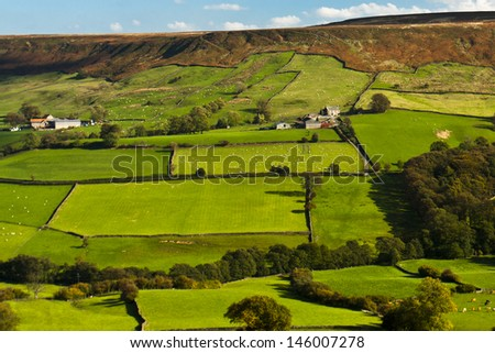 The green fields and stone walls of the North Yorkshire farmland - stock photo