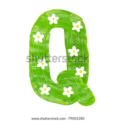 The green letters Q drawn by paints with white blossom