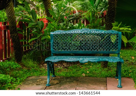 The green metal armchair in the garden