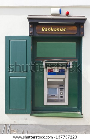 The green street money ATM cash dispense mass production  device  is established in a window of the apartment house