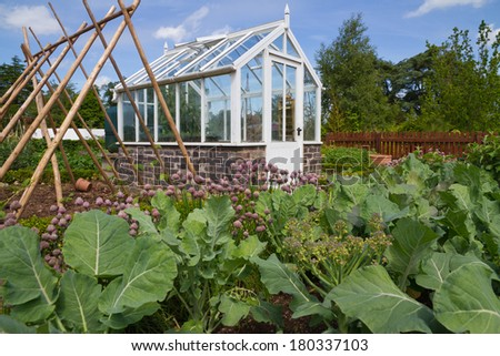 The Greenhouse Takes Pride Of Place In The Small English Vegetable Garden.