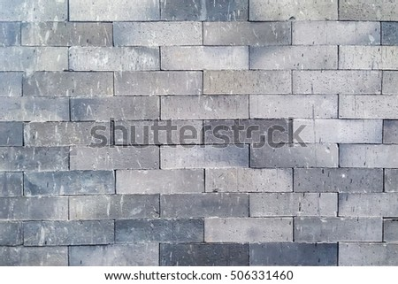 the grey stone wall, the grey brick wall, the grey stone texture as a background