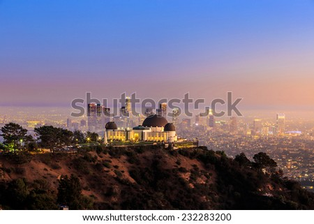 The Griffith Observatory and Los Angeles city skyline at twilight - stock photo