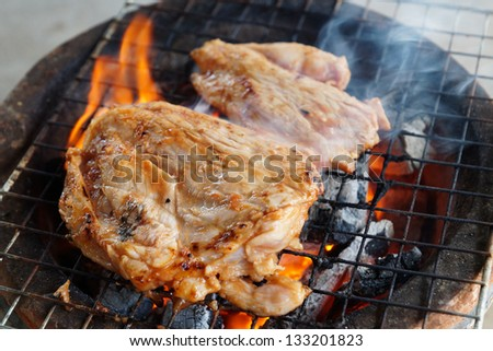 The grilled pork on the grill for dinner party in Thailand