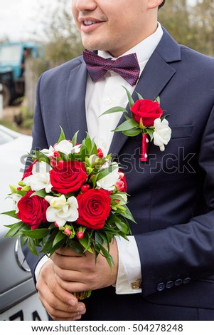 The groom awaits his bride. Just married. Wedding Bridal bouquet flowers