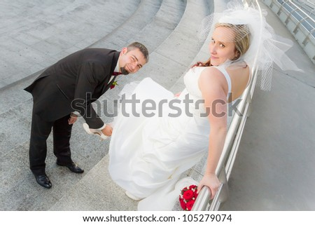 The groom bride wears slipper - stock photo