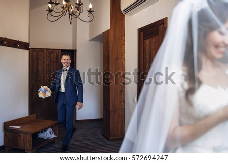 The groom goes to his bride