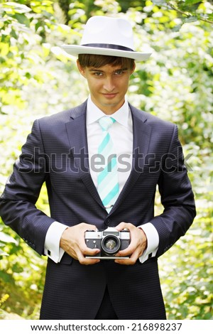 The groom in a suit , photographs vintage camera