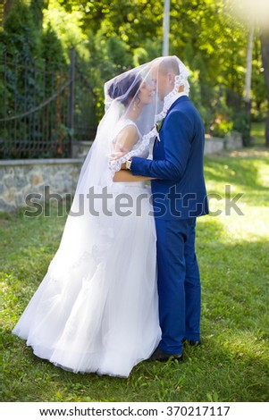The groom kisses the bride on the cheek