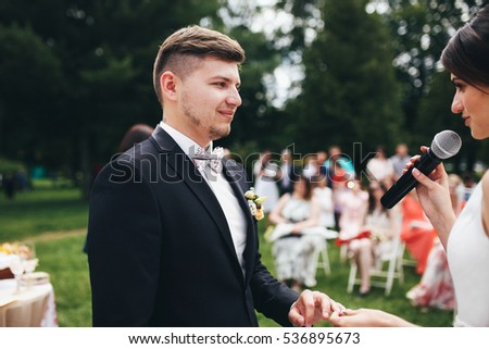 The groom listening his bride on the wedding ceremony