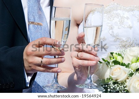 The groom on the bride congratulate each other - stock photo
