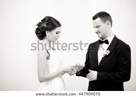 The groom wears a wedding ring