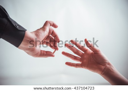 the groom wears wedding ring on the delicate finger of the bride