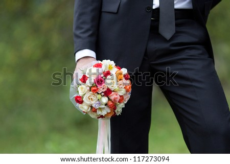 The groom with a wedding bouquet