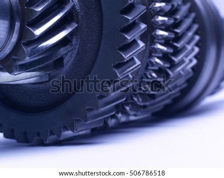 The group of gears, a detail of the mechanism on the white background. Studio high-resolution image.