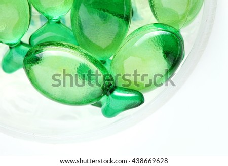 The group of green color vitamin capsules represent the medicine and healthcare concept related idea.