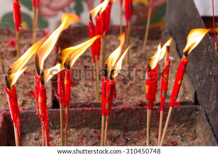The group of red candle in matal incense base - stock photo