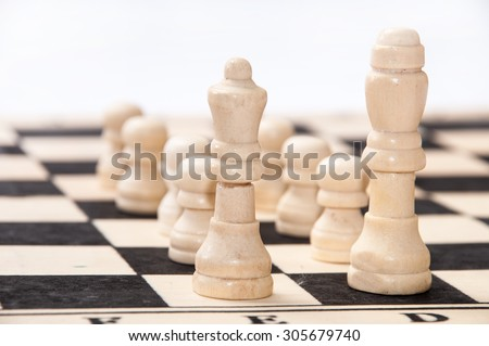 The group of white pieces on the chessboard.