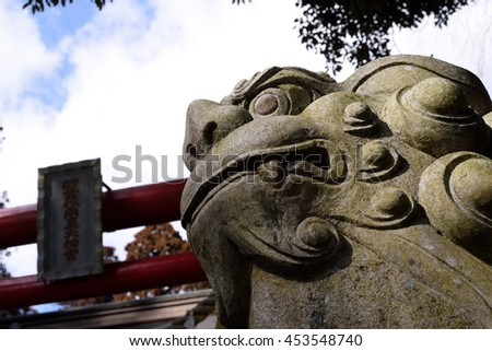 the guardian lion-dog at Shinto shrine