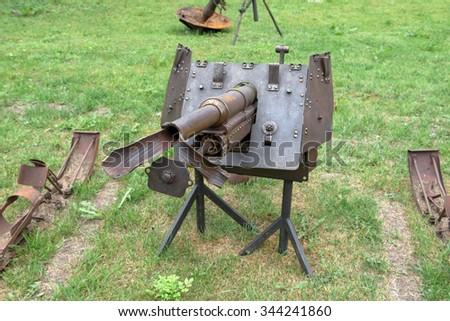 The gun barrel with a torn World War II - stock photo