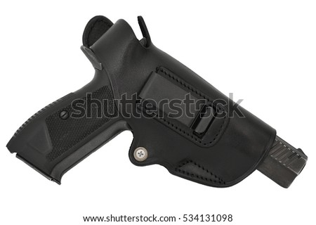 The gun in the holster. Isolated