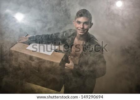 The guy bears a box - stock photo