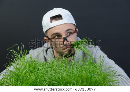 the guy eats the green grass