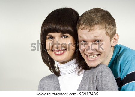 the guy hugs the girl, smiling - stock photo