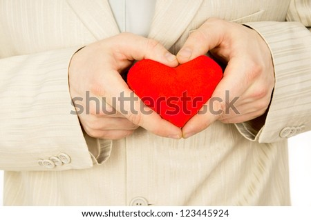 the guy in a suit keeps the heart isolated on white background