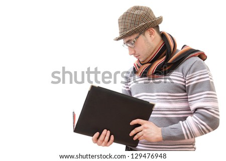 The guy in the hat, glasses and scarf with leather folder in hands - stock photo