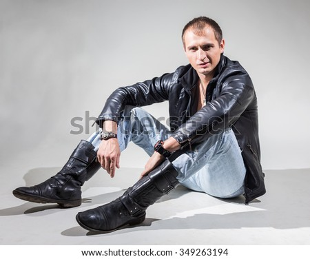 The guy in the leather jacket sitting on white background