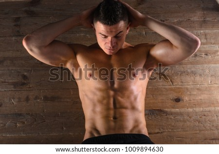 the guy is an athlete , trains the muscles of the abdomen.
