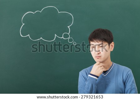 The guy pensive mood, speculates cloud drawn on the chalkboard