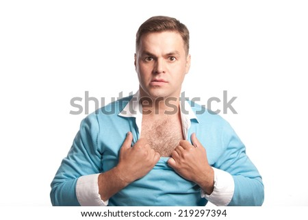 The guy rips his shirt and looking into the camera, isolated - stock photo