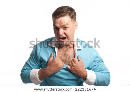 The guy rips his shirt, looking into the camera and shouts, isolated - stock photo