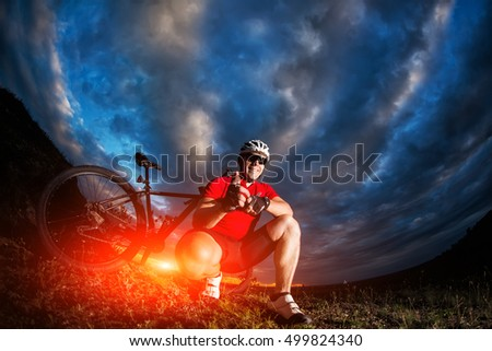 stock-photo-the-guy-with-the-bike-on-top