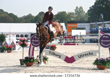 THE HAGUE, HOLLAND - AUGUST 31, 2008: Concours Hippique. Horse clearing a hurdle at the annual horse jumping competition at Westbroek Park.