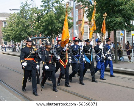 THE HAGUE, HOLLAND - JUNE 26: Veterans carrying flags in the annual parade on Veterans Day on June 26, 2010 in The Hague, Holland.