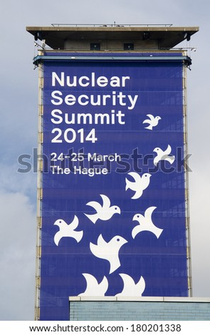 THE HAGUE, HOLLAND - MARCH 1: Large banner on a building for the Nuclear Security Summit 2014 in The Hague, Holland on March 1, 2014 - stock photo