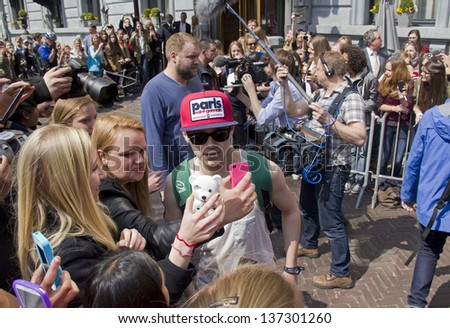 THE HAGUE, HOLLAND - MAY 3: Niall Horan of the boy band One Direction leaves Hotel des Indes among a crowd of teenage fans in The Hague, Holland on May 3, 2013 - stock photo