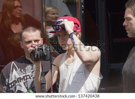 THE HAGUE, HOLLAND - MAY 3: Niall Horan of the boy band One Direction takes pictures of fans from the door of his tourbus in The Hague, Holland on May 3, 2013 - stock photo