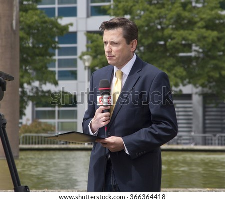 The Hague, Holland - May 27, 2011: Reporter of French television station France 2 in front of the Yugoslavia Tribunal in The Hague, Holland on May 27, 2011 - stock photo