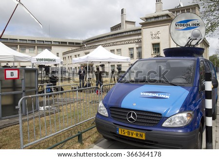 The Hague, Holland - May 27, 2011: TV Crews in front of the Yugoslavia Tribunal in The Hague, Holland, where Serbian ex-general Mladic will be prosecuted for war crimes - stock photo