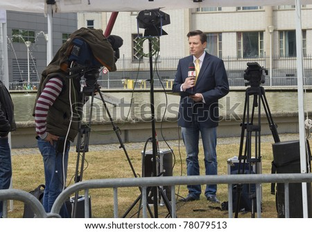 THE HAGUE, HOLLAND - MAY 27:  TV crews wait for the arrival of Serbian ex-general Mladic at Scheveningen prison near The Hague, Holland on May 27, 2011. - stock photo