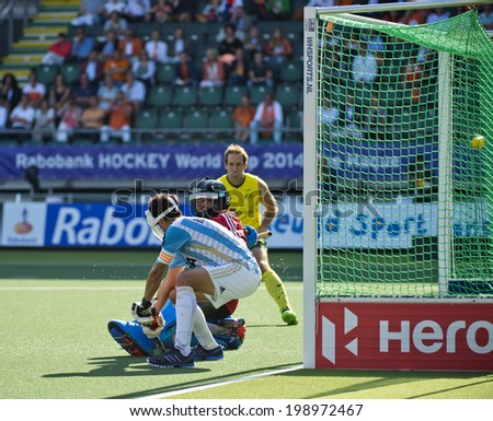 THE HAGUE, NETHERLANDS - JUNE 13: Australia scores against Argentina from a penalty corner during the semi-finals of the World Championships Hockey (5-1) in 2014