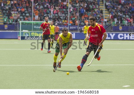 THE HAGUE, NETHERLANDS - JUNE 2: Australian Dwyer is playing the ball followed by the Spanish player Piera during the Hockey World Cup 2014 in the match between Australia and Spain. AUS beats SPA 3-0